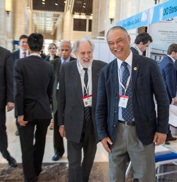 Lord David Puttnam touring the Exhibition, along with Vice Minister H.E. Viraponh Viravong