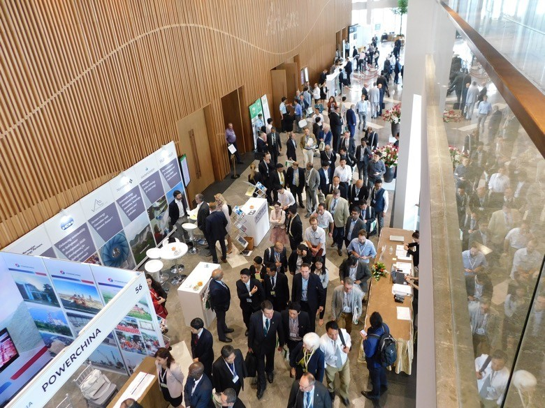 Participants break for coffee in one of the Exhibition areas